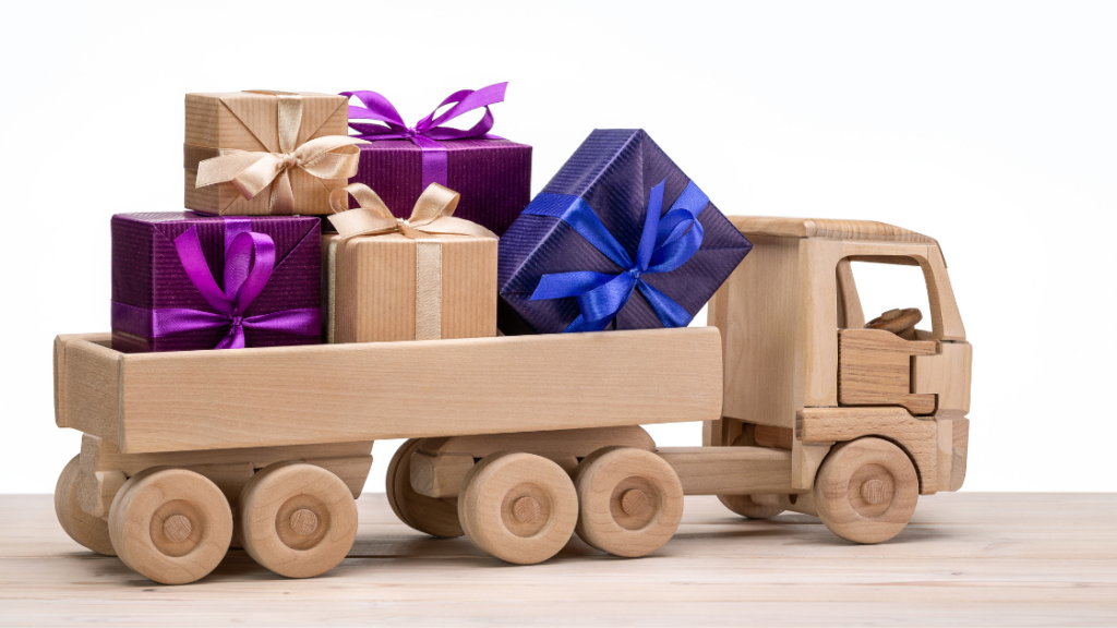 wooden toy truck with colorful gifts at the back
