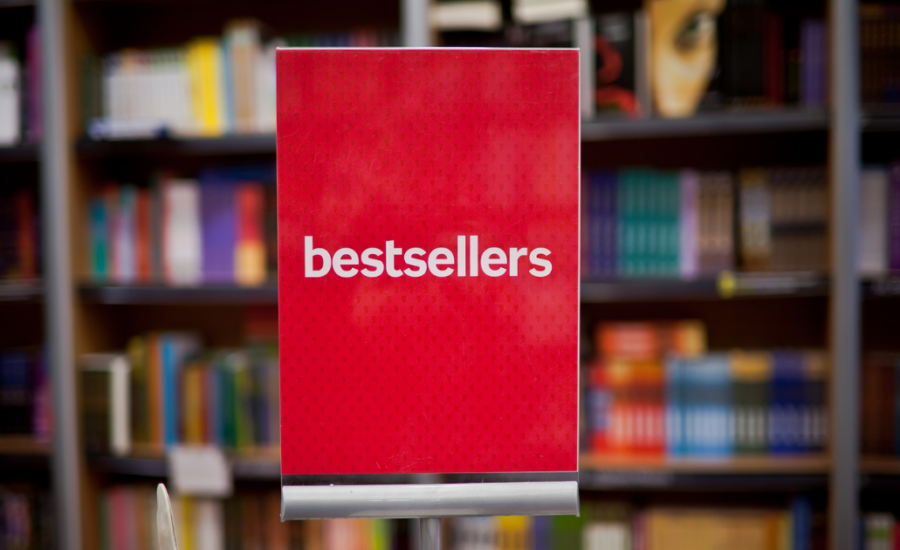 Red sign with white text that says bestsellers